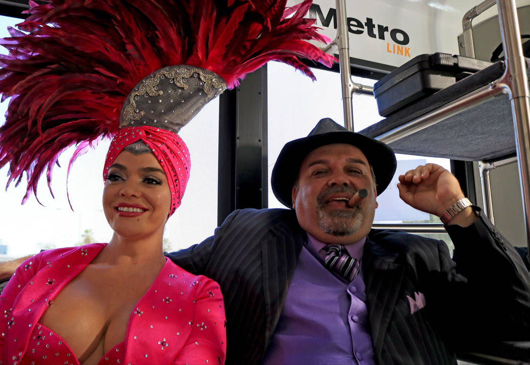 Showgirl Porsha Revesz, left, and Mob impersonator Max Marciano during the Downtown Loop shuttle launch, Tuesday, June, 27 2017. Gabriella Benavidez Las Vegas Review-Journal @latina_ish