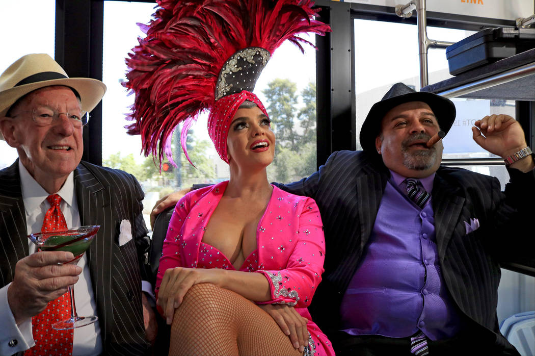 Former Las Vegas Mayor Oscar Goodman, from left, showgirl Porsha Revesz and Mob impersonator Max Marciano, ride a Downtown Loop shuttle, Tuesday, June, 27 2017. Gabriella Benavidez Las Vegas Revie ...
