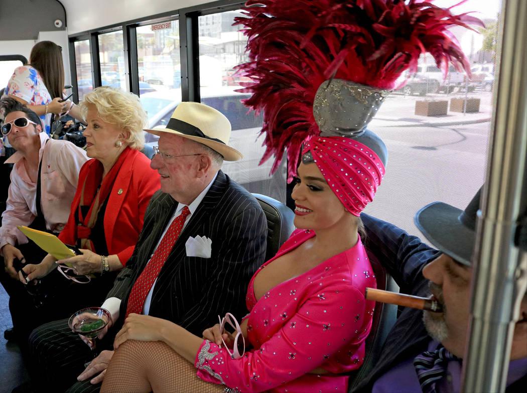 Elvis impersonator Rev. Jesse Garon, from left, Mayor Carolyn Goodman, former Las Vegas Mayor Oscar Goodman, showgirl Porsha Revesz and Mob impersonator Max Marciano ride a Downtown Loop shuttle,  ...