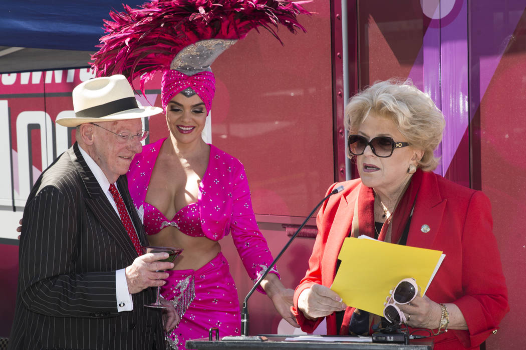 Las Vegas Mayor Carolyn Goodman, right, with former mayor and husband Oscar, left, with showgirl Porsha Revesz, during a celebration ceremony for the new Downtown Loop shuttle bus at Las Vegas Cit ...