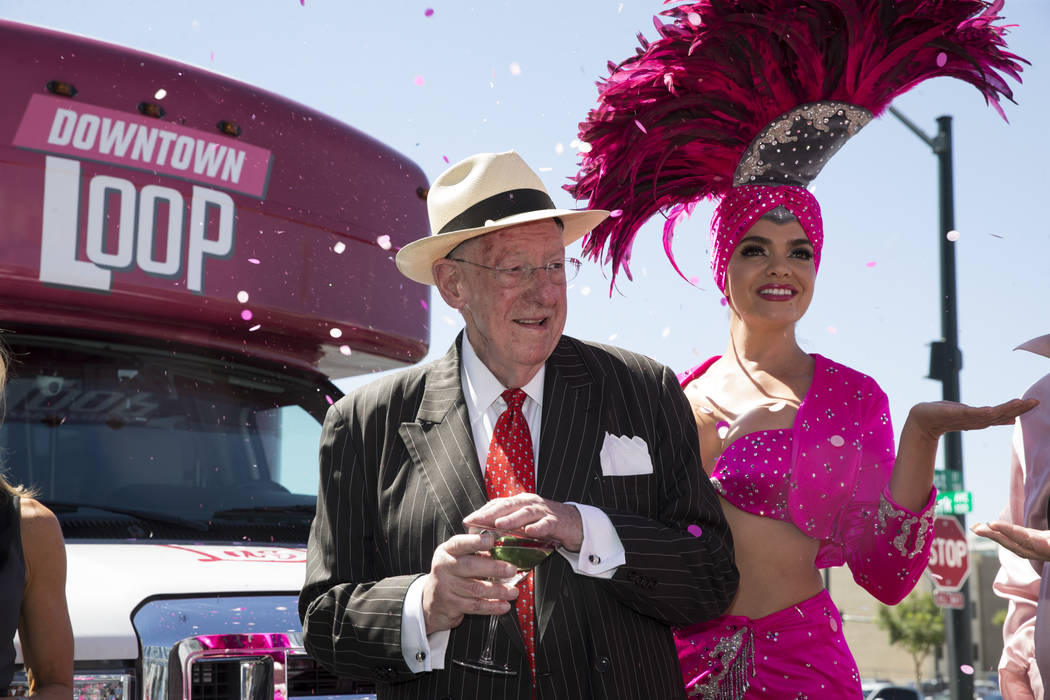 Former Las Vegas Mayor Oscar goodman, left, with showgirl Porsha Revesz, during a celebration ceremony for the new Downtown Loop shuttle bus at Las Vegas City Hall in Las Vegas, Tuesday, June 27,  ...