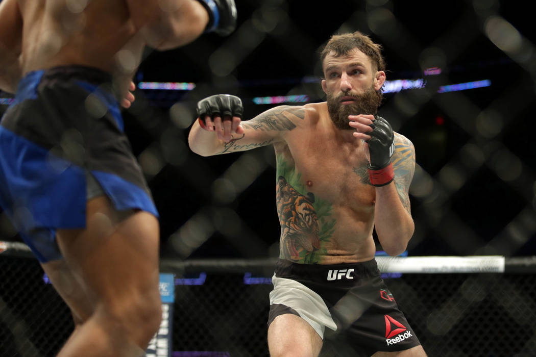 Jun 25, 2017; Oklahoma City, OK, USA; Michael Chiesa (red gloves) fights Kevin Lee (blue gloves) during UFC Fight Night at Chesapeake Energy Arena. (Sean Pokorny/USA Today Sports)