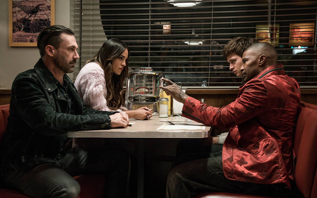 (l to r) Buddy (Jon Hamm), Darling (Eiza Gonzalez), Baby (Ansel Elgort) and Bats (JAMIE FOXX) discuss the next heist in TriStar Pictures' BABY DRIVER.