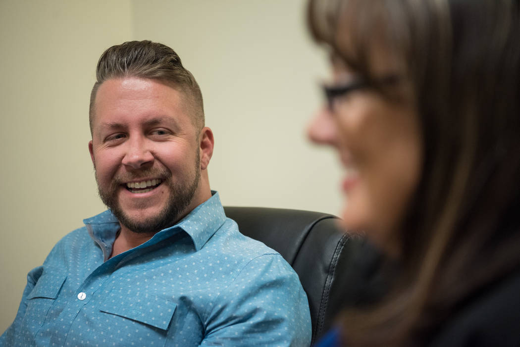 Travis Turner, executive director at Executive Pride, and Civil litigation attorney and Executive Pride member Rena McDonald talk about the gay rights movement at McDonald Law Group in Henderson o ...