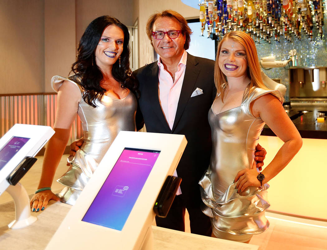 Robotic Innovations Chairman Rino Armeni with Galactic Ambassadors Aliz Havadi, left, and Shani Bever at Tipsy Robot in the Miracle Mile Shops in Las Vegas, Monday, June 26, 2017. (Chitose Suzuki  ...