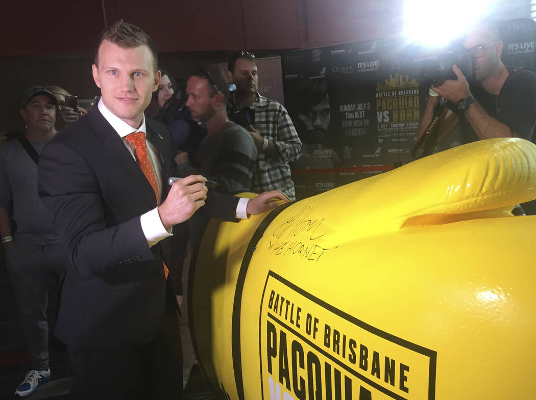 Boxer Jeff Horn of Australia poses for a photo following a press conference with Manny Pacquiao of the Philippines in Brisbane, Wednesday, June 28, 2017. Pacquiao, is putting his WBO belt on the l ...