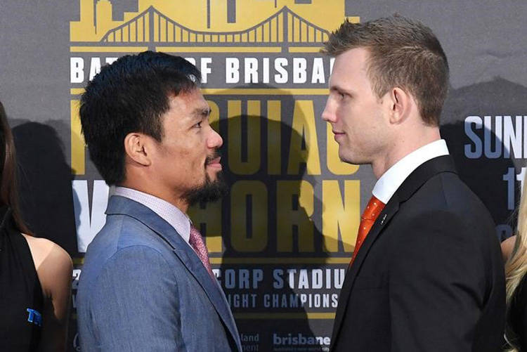 Boxers Manny Pacquiao of the Philippines and Australia's Jeff Horn stand together following their official news conference ahead of their WBO welterweight fight in Brisbane, Australia June 28, 201 ...