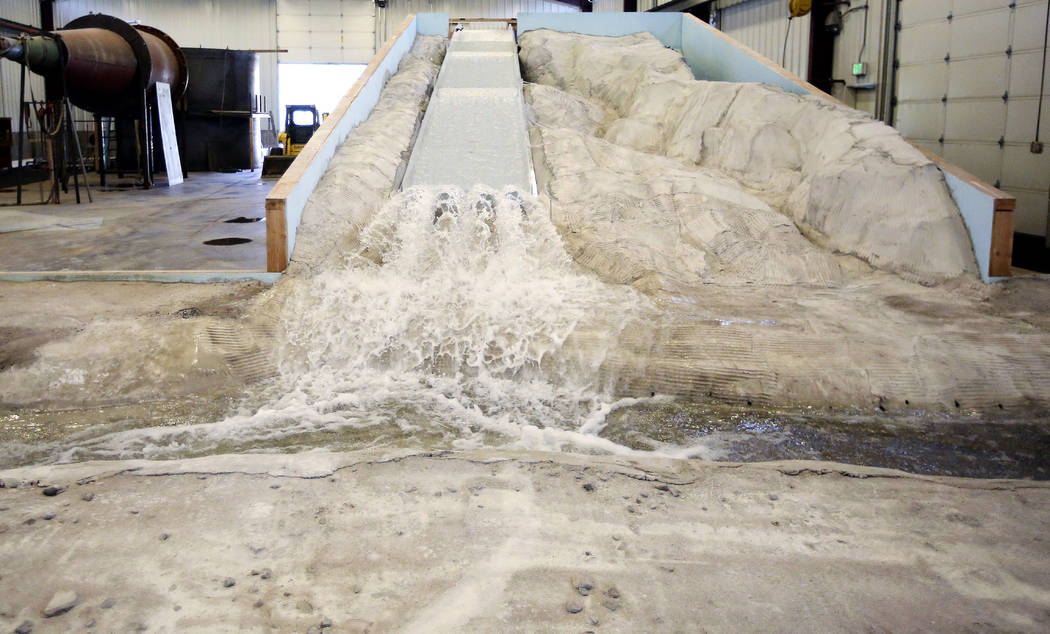 In this Friday, June 16, 2017, photo, water flows from a replica of the Oroville Dam spillway at Utah State University's Water Research Laboratory, in Logan, Utah. California water officials are r ...