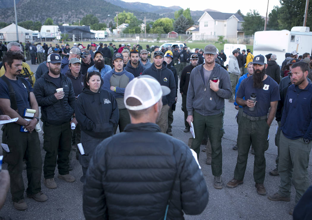 Firecrews and personal gather for a morning briefing on the Brian Head Fire at the Iron Country Fairgrounds on Tuesday, June 27, 2017 in Parowan, Utah. Crews came from all over the west, and Great ...