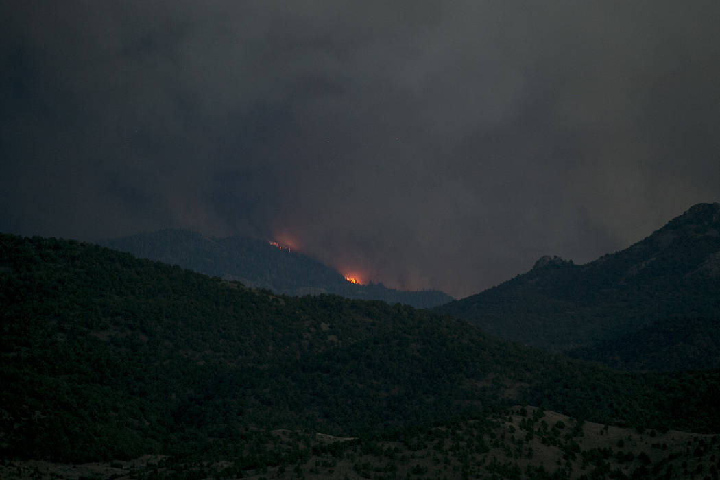 Flames from the blaze of Brian Head Fire are seen off Utah's State Route 20, north of Dixie National Forest on Monday, June 26, 2017. Bridget Bennett Las Vegas Review-Journal @bridgetkbennett