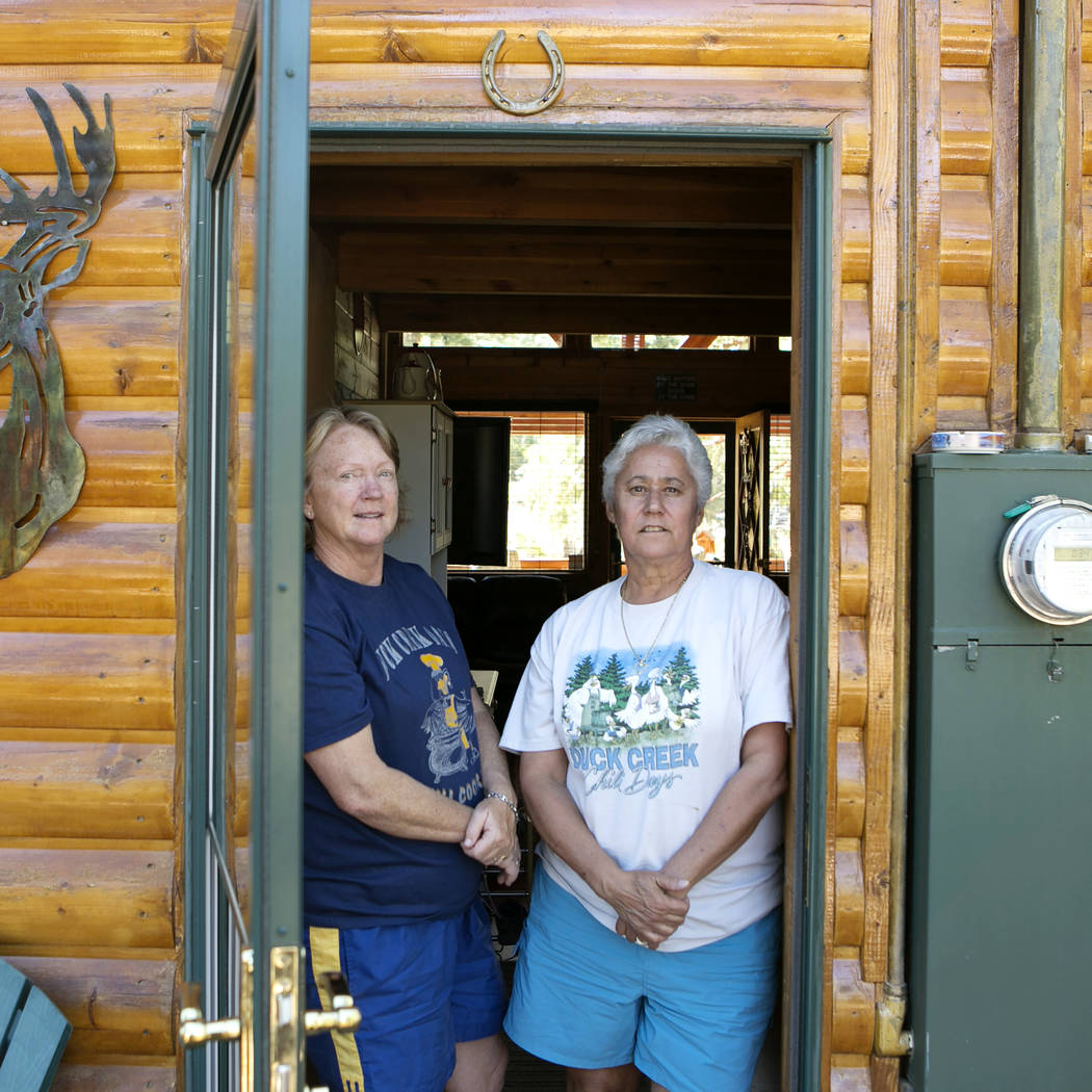 Henderson residents Mary Stengel, left, and Terri Corrado, right, are pictured in the doorway at their second home at Duck Creek Village, Utah on Tuesday, June 27, 2017. The couple voluntarily eva ...