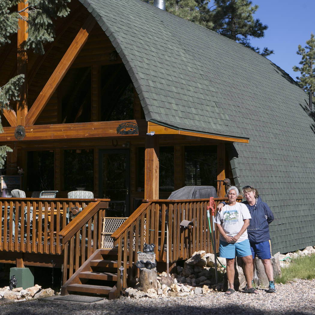 Henderson residents Terri Corrado, left, and Mary Stengel, right, are pictured outside their second home at Duck Creek Village, Utah on Tuesday, June 27, 2017. The couple voluntarily evacuated the ...