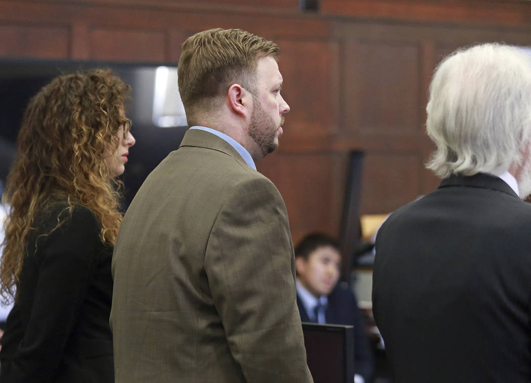Defendant Michael P. McCarthy, center, reacts after a guilty of second degree murder verdict against him at Suffolk Superior Court on Monday, June 26, 2017. (Matt West/The Boston Herald via AP, Pool)