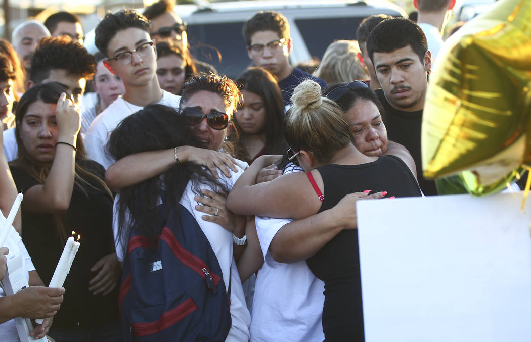 Brenda Covarrubias, far right, whose nephew Oscar Ayala was one of two teenagers killed in a crash caused by a drunk driver this past Saturday, is consoled during a candlelight vigil at Marion Dri ...