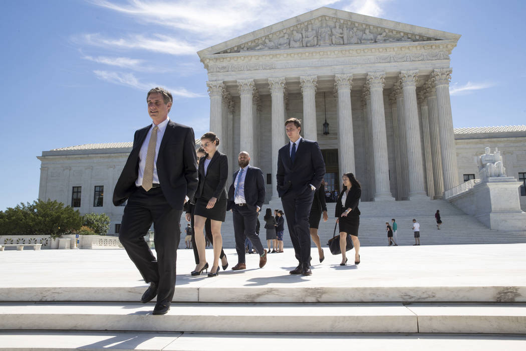 People leave the Supreme Court in Washington, Monday, June 26, 2017, as justices issued their final rulings for the term. (J. Scott Applewhite/AP)