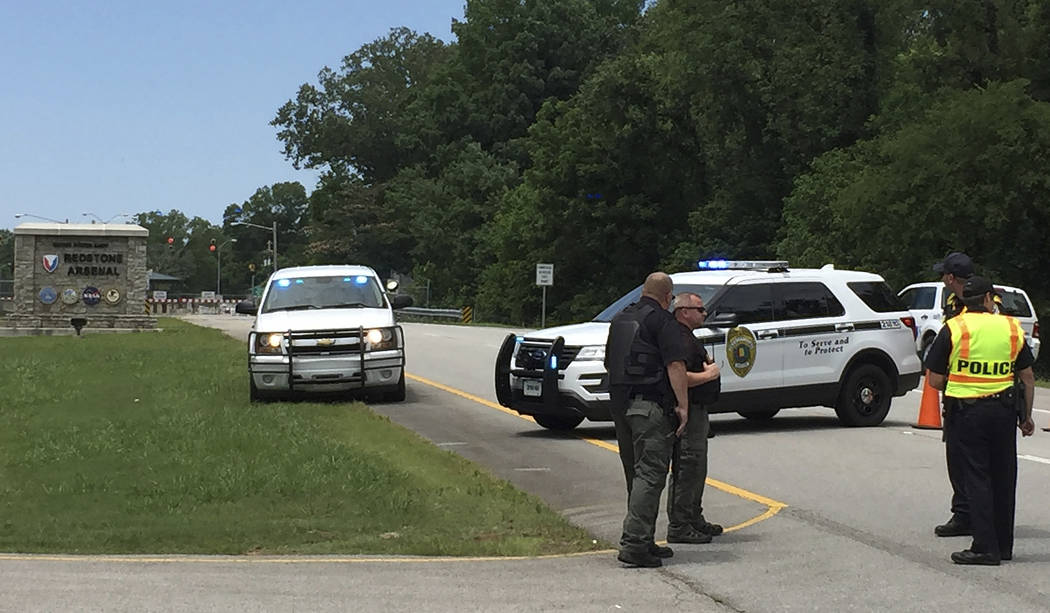 Authorities block an entrance to Redstone Arsenal, Tuesday, June 27, 2017, in Huntsville, Ala. The military post said in a tweet it was on lockdown Tuesday amid reports of possible active shooter, ...