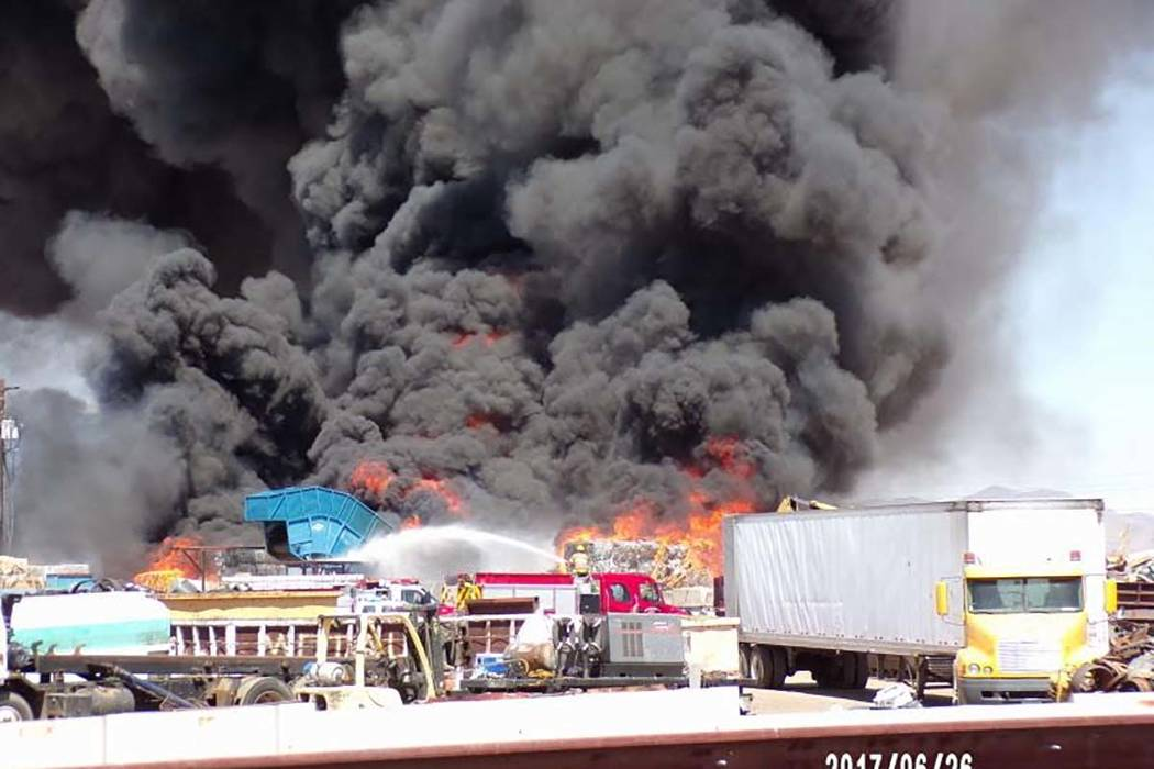 Multiple agencies battled a fire at Bulldog Disposal, a recycling center in Kingman, Arizona, on Monday, June 26, 2017. (Bob Sodaro/Northern Arizona Consolidated Fire District)