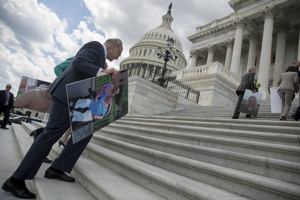 Senate Minority Leader Sen. Chuck Schumer of N.Y. walks back into the Capitol after speaking about the proposed Republican Senate healthcare bill to reporters outside the Capitol Building in Washi ...
