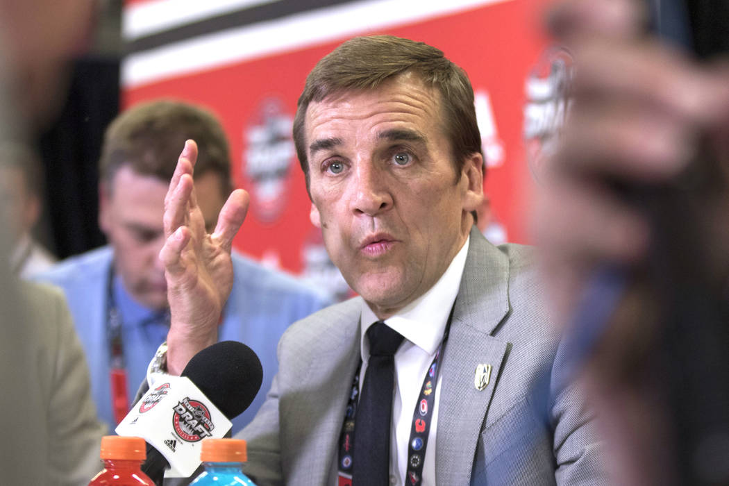 Vegas Golden Knights general manager George McPhee responds to questions at a media scrum following the first round of the 2017 NHL Entry Draft at the United Center in Chicago on Friday, June 23,  ...