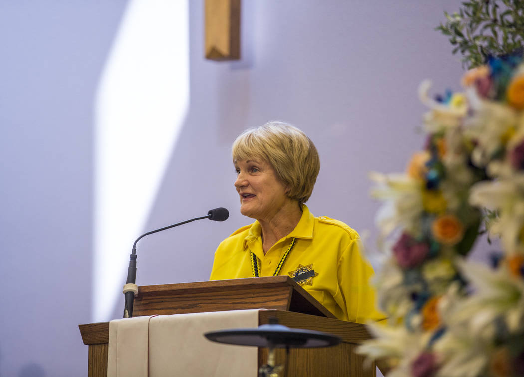 "Sharon Harding, a Metropolitan Police Volunteer, shares fond memories at the funeral service for Richard ""Dick"" Bennett, a Metro Police Volunteer with over 20,000 hours of servic ..."