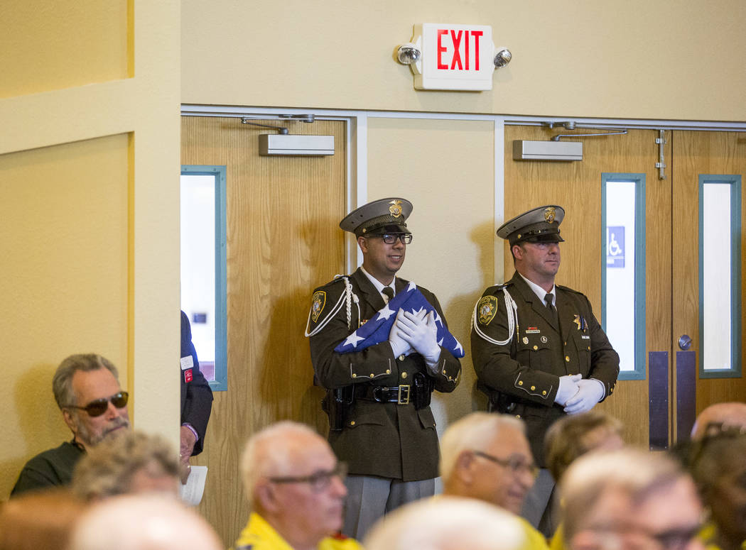 "The Metropolitan Police Honor Guard stand by during the funeral service for Richard ""Dick"" Bennett, a Metro Police Volunteer with over 20,000 hours of service, at the Mountain Vi ..."