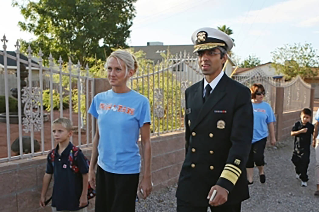 Myrtle Tate Elementary School Principal Sarah Popek, second from left, walks with her son, left, and former U.S. Surgeon General Vivek Murthy during a group walk at the school  Tuesday, Sept 15, 2 ...