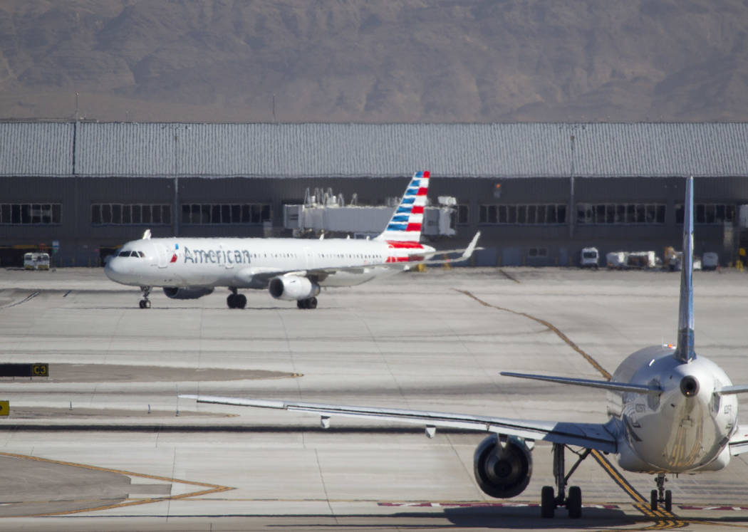 Planes taxi the runway at McCarran International Airport in Las Vegas on Wednesday, June 28, 2017. Richard Brian Las Vegas Review-Journal @vegasphotograph