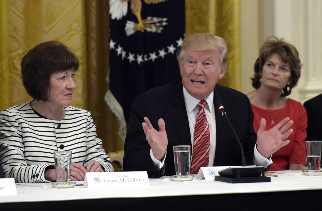 President Donald Trump, center, speaks as he meets with Republican senators on health care in the East Room of the White House in Washington, Tuesday, June 27, 2017. Sen. Susan Collins, R-Maine, l ...
