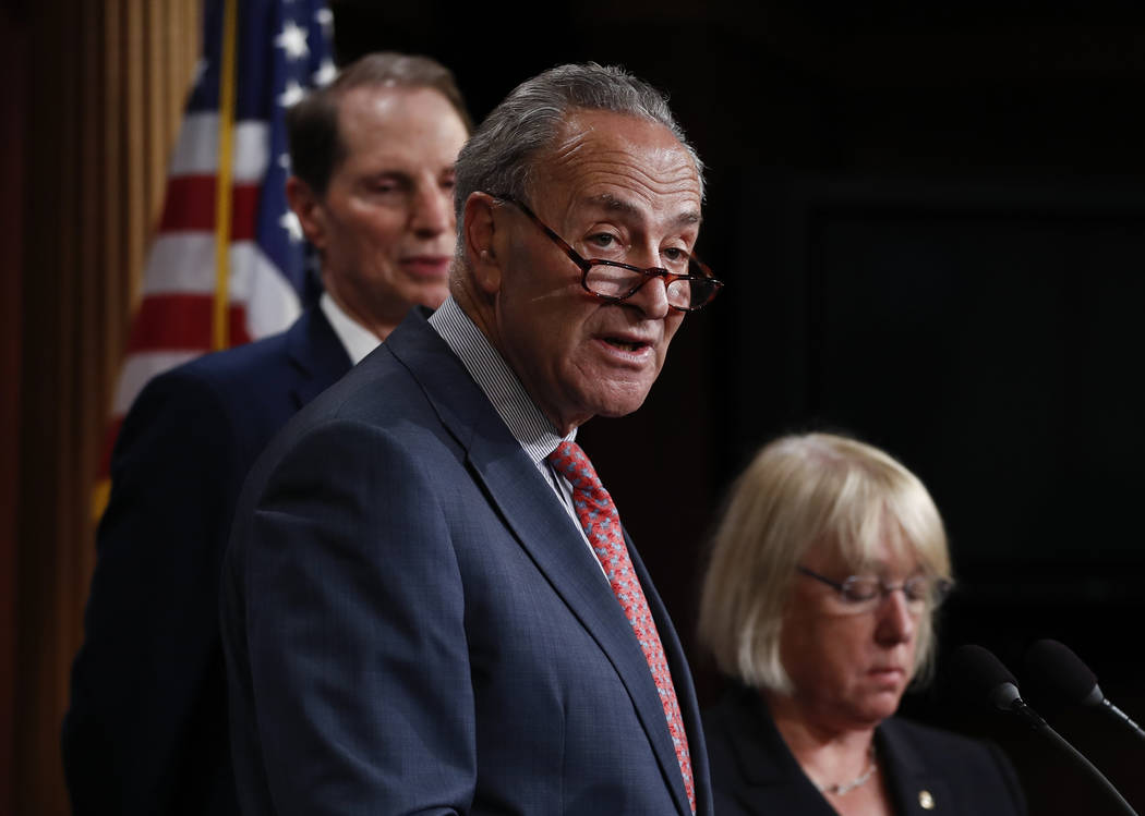 Senate Minority Leader Chuck Schumer, D-N.Y., center, joined by Sen. Patty Murray, D-Wash., right, and Sen. Ron Wyden, D-Ore., left, speaks during a new conference on Capitol Hill in Washington, M ...