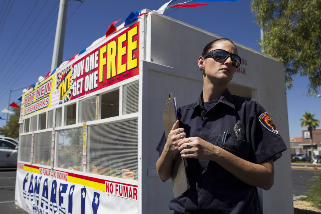 Amanda Wildermuth, Clark County fire prevention inspector, before an inspection of a fireworks stand near the intersection of South Rainbow Boulevard and Windmill Lane in Las Vegas, Wednesday, Jun ...