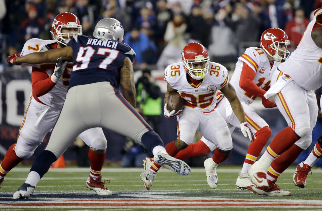 In this photo taken Jan.16, 2016, New England Patriots defensive tackle Alan Branch (97) closes in on Kansas City Chiefs running back Charcandrick West (35)  in the first half of an NFL divisional ...