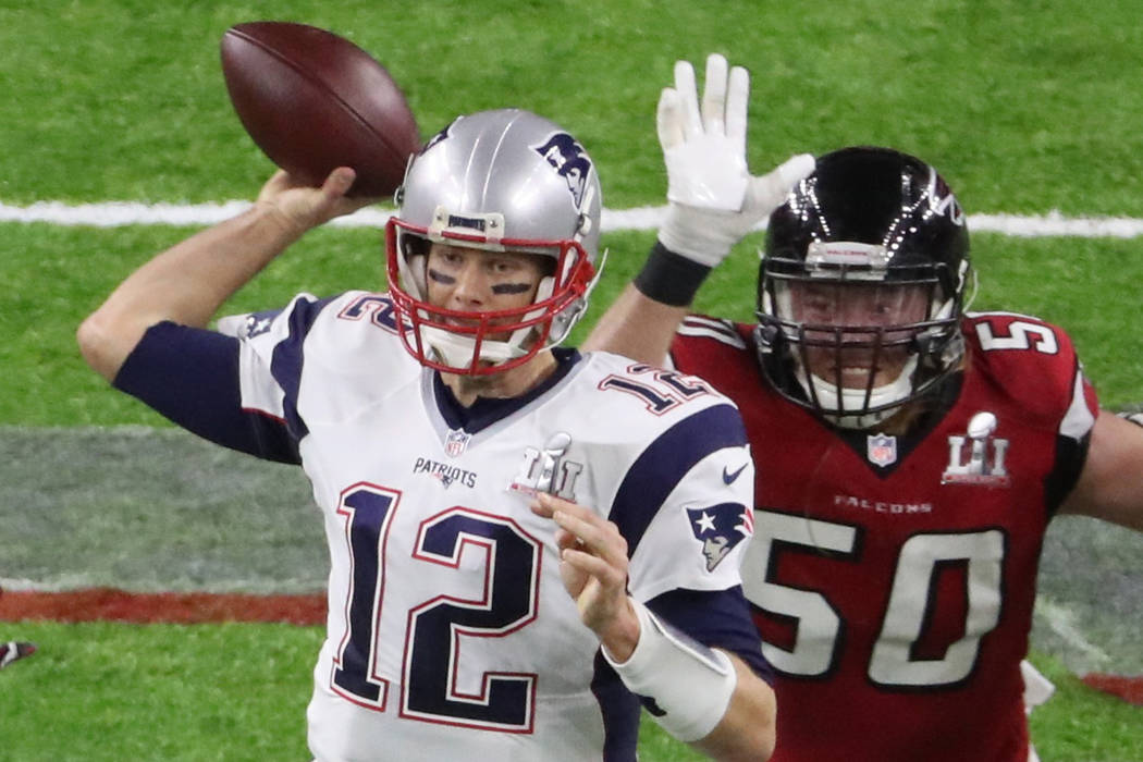 Atlanta Falcons' Brooks Reed (R) puts pressure on New England Patriots' quarterback Tom Brady during the second quarter of Super Bowl LI in Houston, Texas, U.S., February 5, 2017. REUTERS/Richard  ...