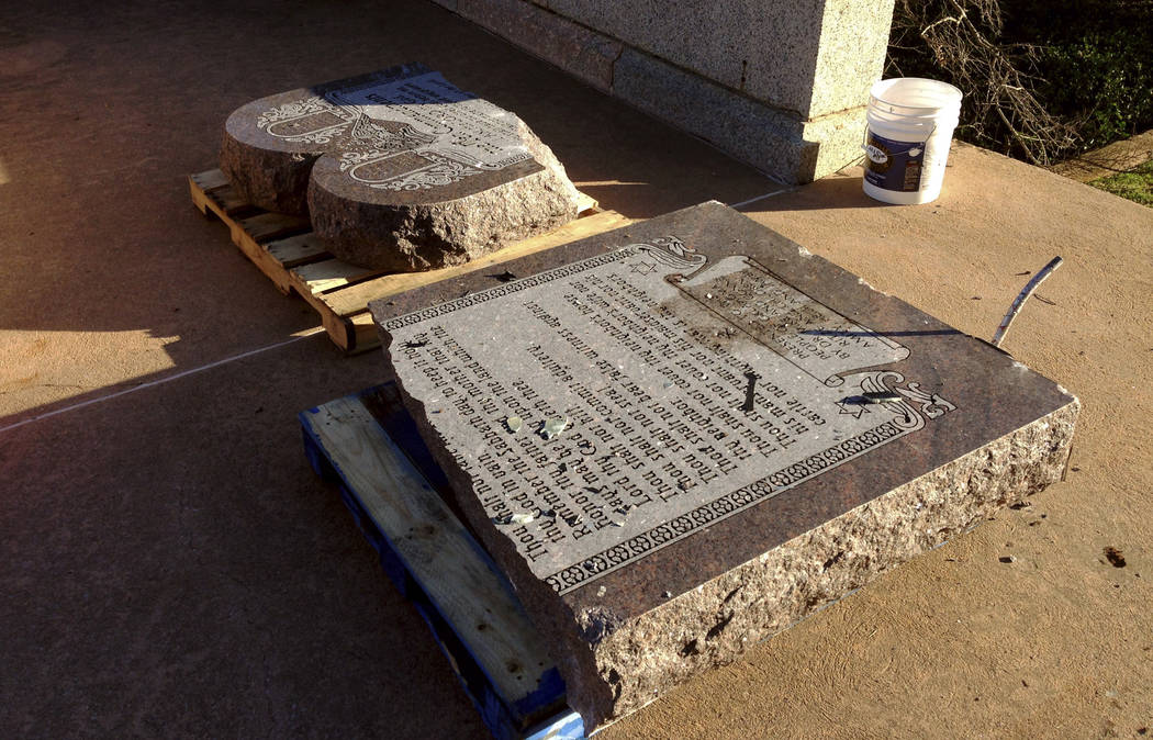 The damaged remains of a Ten Commandments monument lie on the state Capitol grounds on Oct. 24, 2014, in Oklahoma City after driver, Michael Tate Reed of Van Buren, Ark., crashed into the statue.  ...