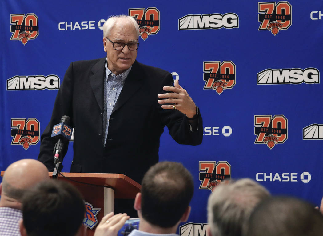 In this April 14, 2017, file photo, New York Knicks president Phil Jackson answers questions during a news conference at the team's training facility in Greenburgh, N.Y. The Knicks and Jackson par ...