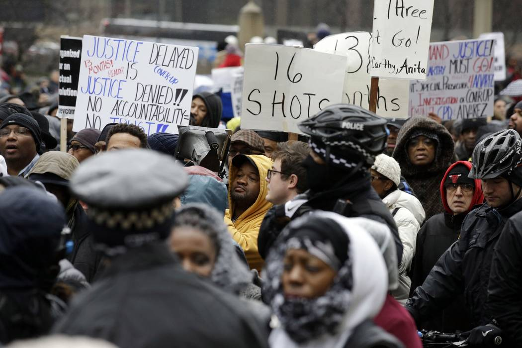 "Protesters take part in a ""march for justice""  in Chicago on Nov. 27, 2015, in the wake of the release of video showing an officer fatally shooting Laquan McDonald. (Nam Y. Huh/AP, File)"