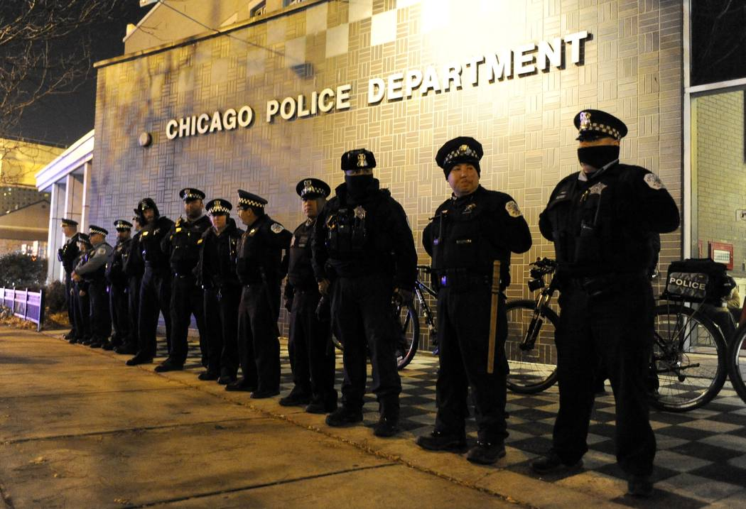 Chicago police officers line up outside the District 1 central headquarters in Chicago on Nov. 24, 2015, during a protest for the fatal police shooting of 17-year-old Laquan McDonald. (Paul Beaty/ ...