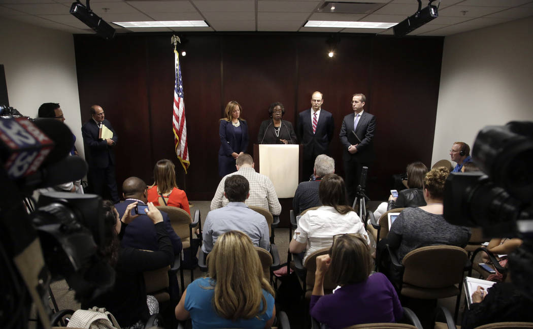 Special prosecutor Patricia Brown-Holmes, center, speaks during a news conference Tuesday, June 27, 2017 in Chicago. Brown-Holmes announced that three Chicago police officers have been indicted on ...