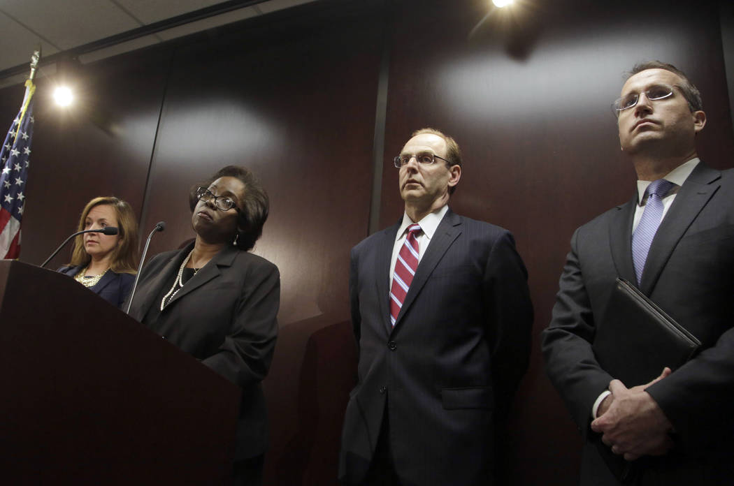 Special prosecutor Patricia Brown-Holmes, second from left, speaks during a news conference, Tuesday, June 27, 2017 in Chicago. Brown-Holmes announced that three Chicago police officers have been  ...