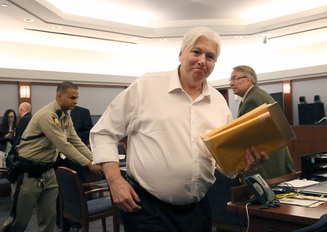 Thomas Randolph, who is accused of hiring a hitman to kill his last wife and killed the hitman, leaves the courtroom after being found guilty on two counts of murder and one count of conspiracy to ...