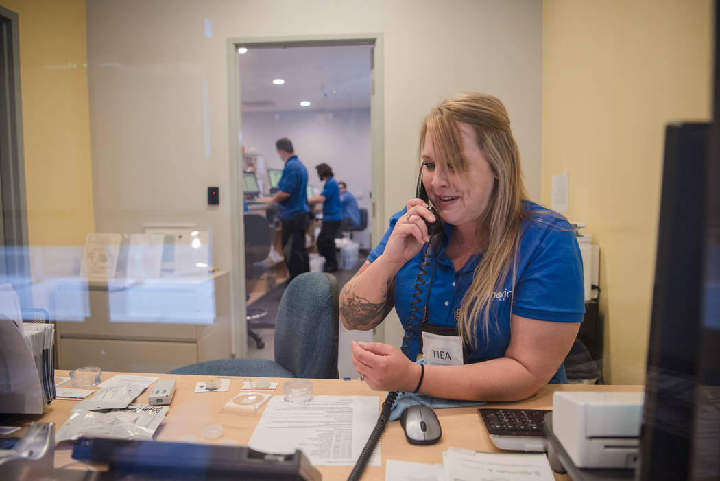 Tiea Perkins answers a phone call at the front desk at Euphoria Wellness on Thursday, June 29, 2017, in Las Vegas. Morgan Lieberman Las Vegas Review-Journal