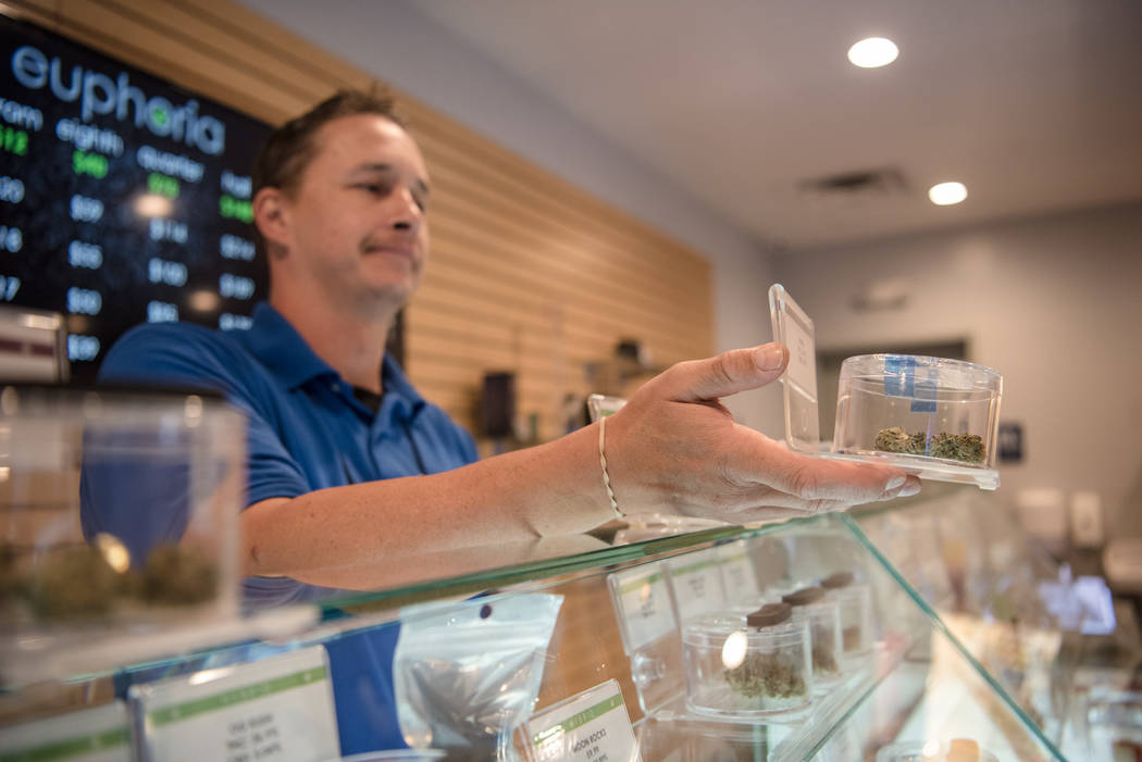 Jayson Stutsman bringing out a product from the display case at Euphoria Wellness on Thursday, June 29, 2017, in Las Vegas. Morgan Lieberman Las Vegas Review-Journal