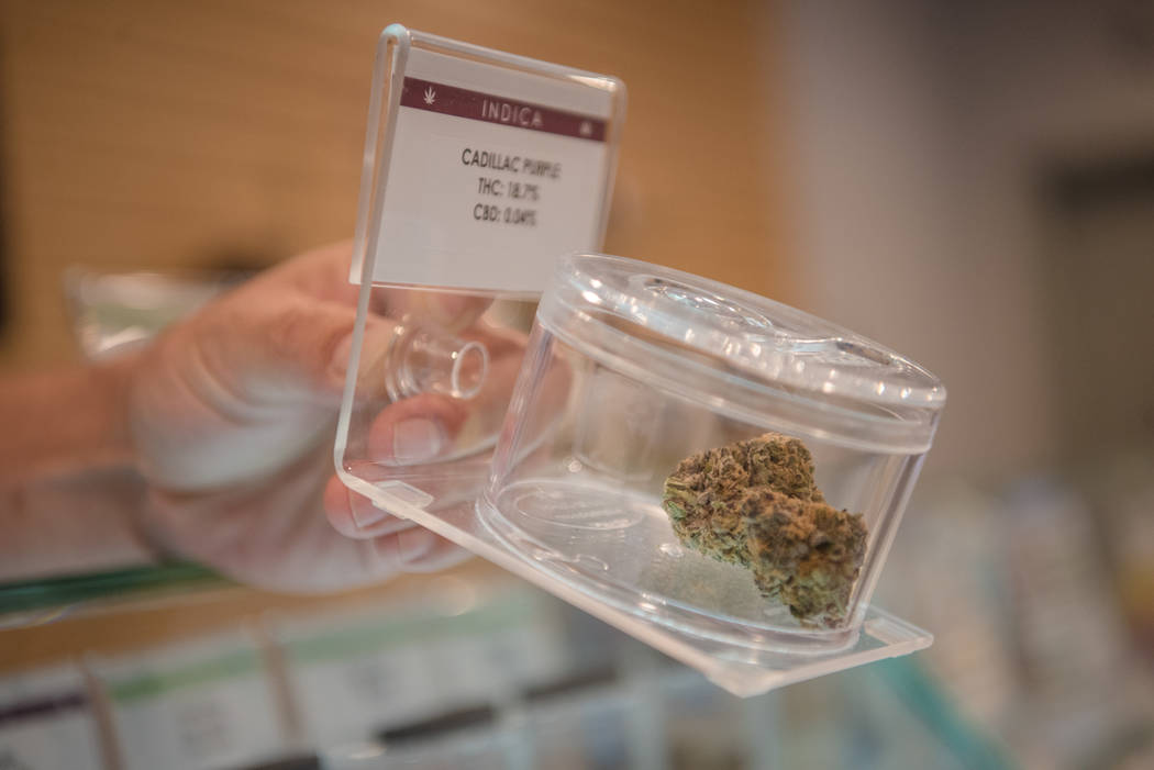 Jayson Strutsman bringing out a product from the display case at Euphoria Wellness on Thursday, June 29, 2017, in Las Vegas. Morgan Lieberman Las Vegas Review-Journal