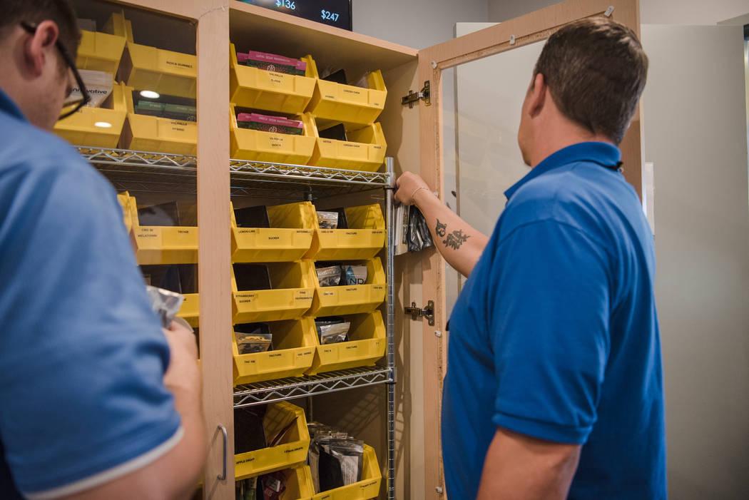 Jayson Stutsman looking at the inventory cabinet  at Euphoria Wellness on Thursday, June 29, 2017, in Las Vegas. Morgan Lieberman Las Vegas Review-Journal