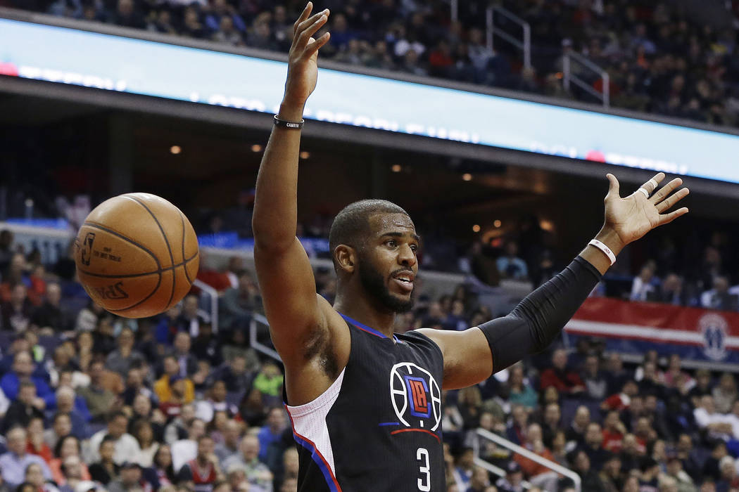 In this Dec. 28, 2015, file photo, Los Angeles Clippers guard Chris Paul reacts after dunking the ball during the first half of an NBA basketball game against the Washington Wizards, in Washington ...