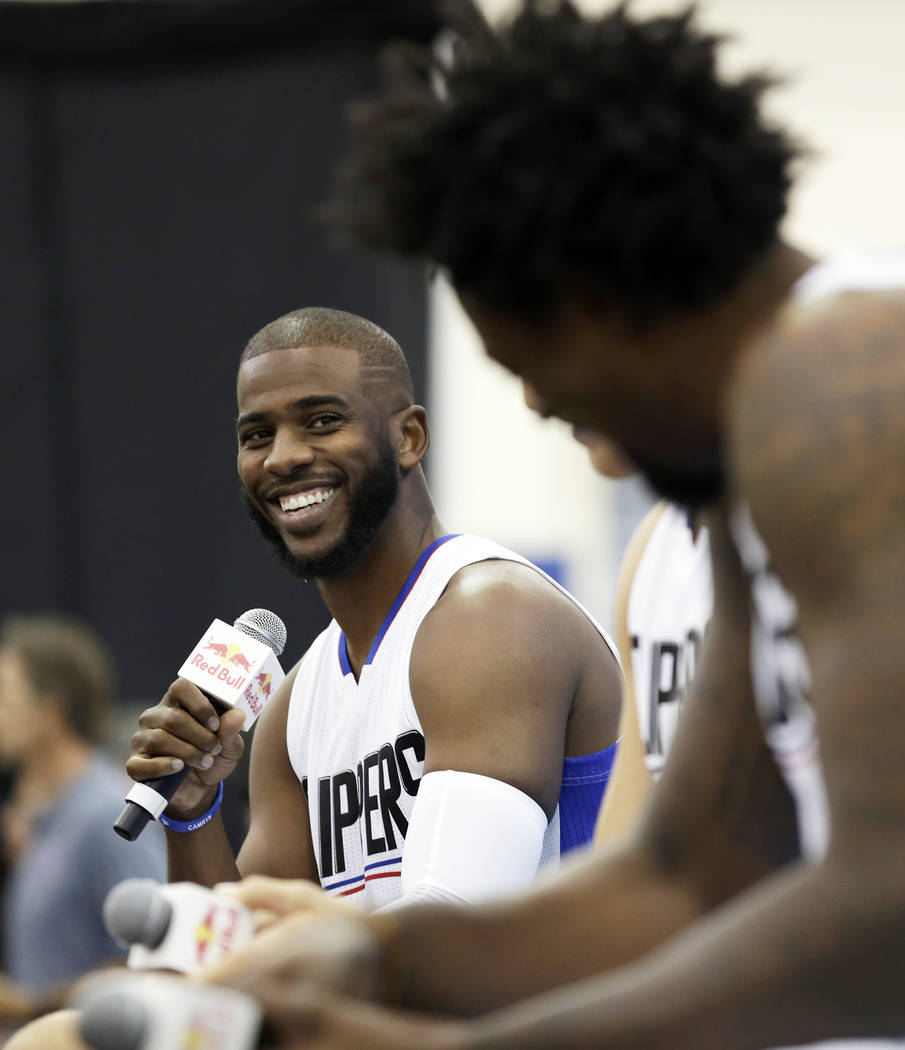 In this Sept. 26, 2016, file photo, Los Angeles Clippers' Chris Paul laughs as he, Blake Griffin and DeAndre Jordan, right, talk during the team's NBA basketball media day, in Playa Vista, Calif.  ...