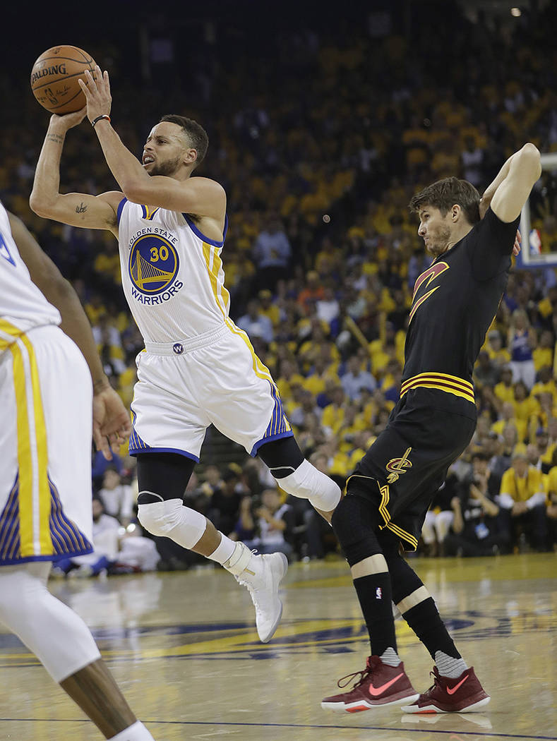 Golden State Warriors guard Stephen Curry (30) shoots against Cleveland Cavaliers guard Kyle Korver during the first half of Game 5 of basketball's NBA Finals in Oakland, Calif., Monday, June 12,  ...