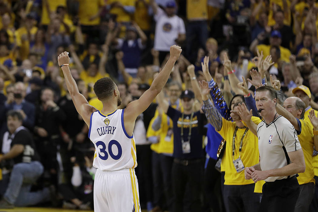 Golden State Warriors guard Stephen Curry (30) celebrates with fans after Game 5 of basketball's NBA Finals between the Warriors and the Cleveland Cavaliers in Oakland, Calif., Monday, June 12, 20 ...