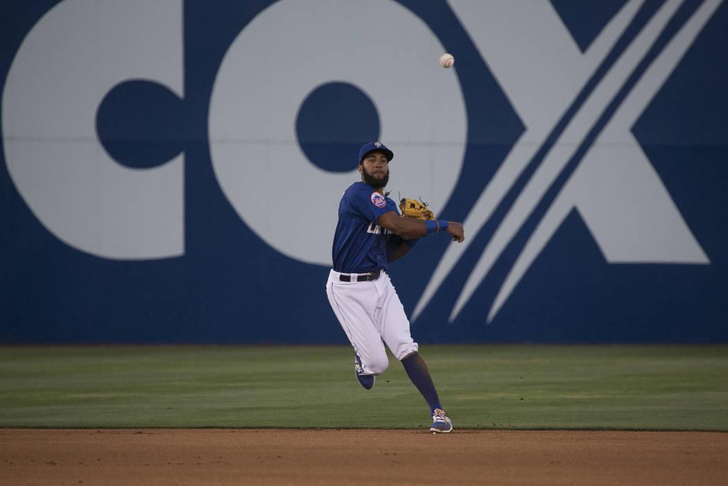 51s Amed Rosario (1) passes the ball during the first inning against Albuquerque at Cashman Field on Thursday, April 27, 2017, in Las Vegas. Bridget Bennett/Las Vegas Review-Journal @bridgetkbennett
