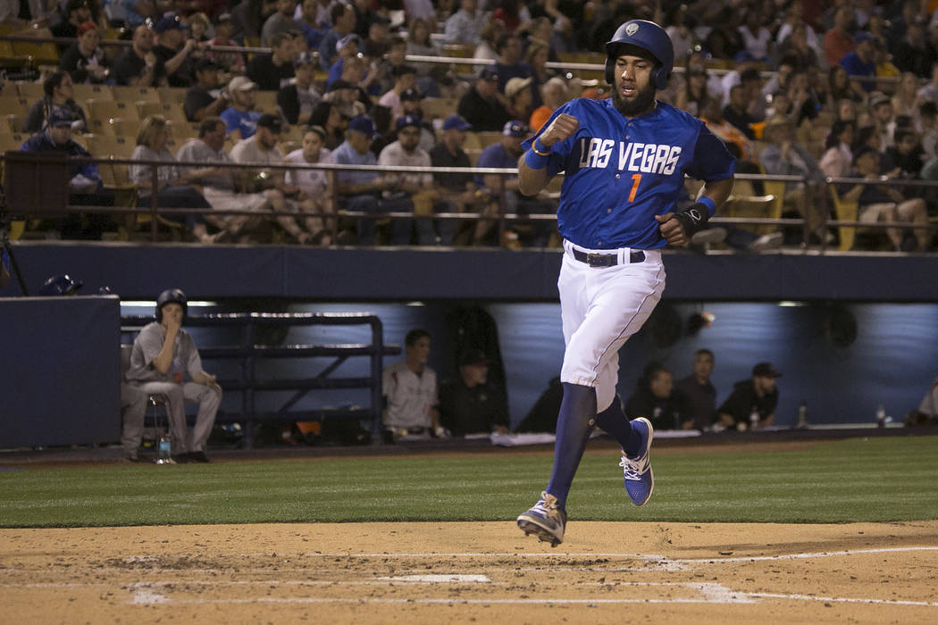 51s Amed Rosario (1) makes his way safely to home plate during the third inning in a game against Albuquerque at Cashman Field on Thursday, April 27, 2017, in Las Vegas. Bridget Bennett/Las Vegas  ...