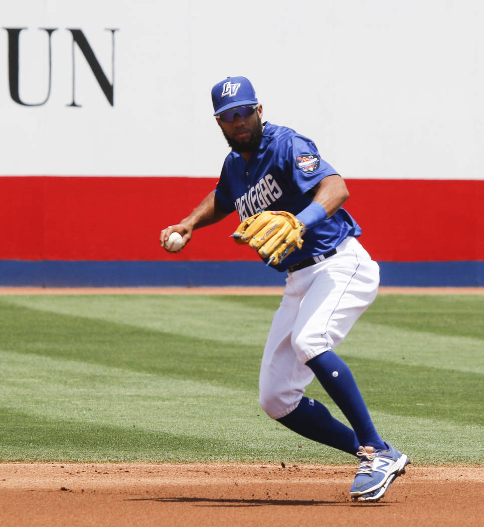 Las Vegas 51s' Amed Rosario looks to throw to first base during a baseball game against El Paso at Cashman Field in Las Vegas on Tuesday, May 30, 2017. Chase Stevens Las Vegas Review-Journal @csst ...